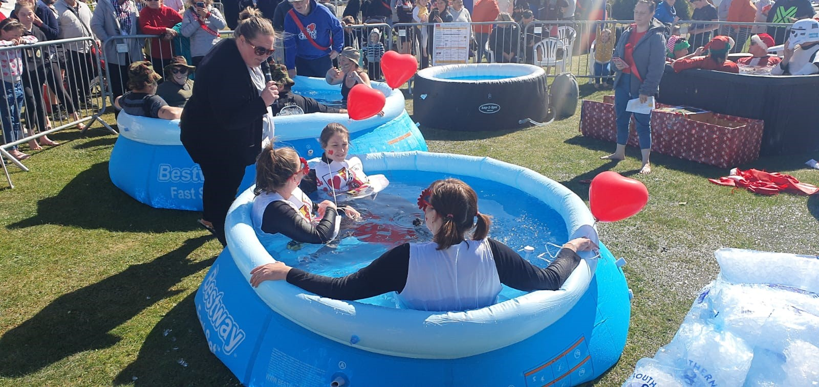 people sat in inflatable pool at fundraising event